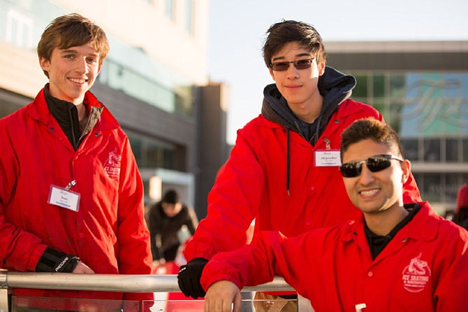 Sam Ellis, 16, junior at Marshall High School, from Vienna, a skate host, Alejandro Catacora, 16, sophomore at Albert Einstein High School, and Amir Sefat, manager on duty Saturday, George Mason University senior, pictured at the ice skating rink at Tysons Corner Center Saturday, Dec. 16.