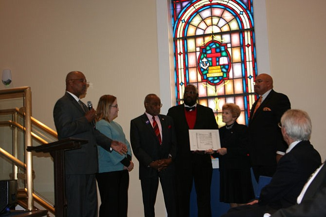 From left: MacArthur Myers; Krystyn Moon, Ph.D., University of Mary Washington; former Mayor Bill Euille; Councilmembers John Chapman and Del Pepper; the Rev. James V. Jordan, Third Baptist Church; and Dr. F.J. Pepper recognize the election of George Washington Parker, the first African-American councilman to serve Alexandria.
