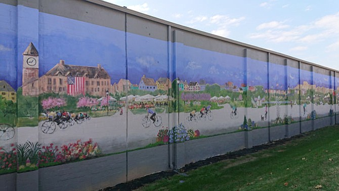 "The Mural at Greenhill Properties, located on the Edsall Road side of the building at 611 S. Pickett St., was officially unveiled Nov. 30 by city officials and local artists Cindy Wallace and Len Garon. Called ""Time Travel,"" the mural is two stories high and 300 feet long and depicts the local history of the area."