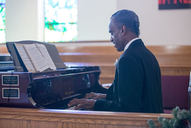 Isaac Howard, 60, of Burke plays the piano at Mt. Calvary Baptist Church in Fairfax Wednesday, Dec. 27.