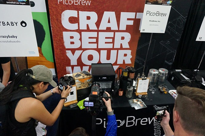 Members of the media get a closer look at the home brewing design of Pico Brew Jan. 7 at CES Unveiled in Las Vegas.