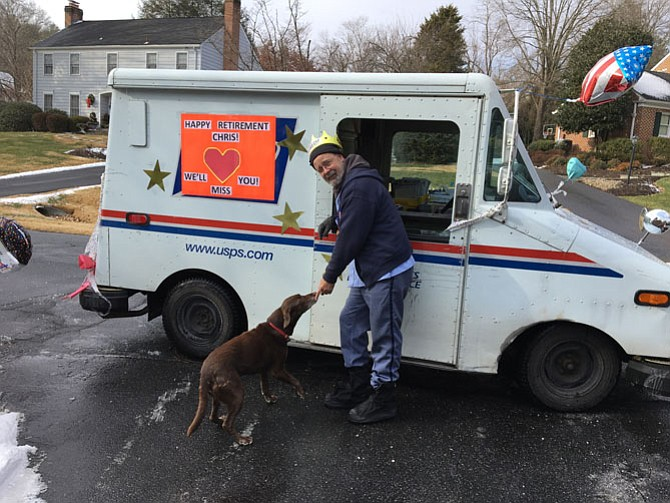 Letter carrier Christopher Bucy pauses by his mail truck, decorated in honor of his last day on the job. Bucy retired Dec. 30 after 31 years of service, 17 as carrier in the McAuley Park neighborhood of Potomac.