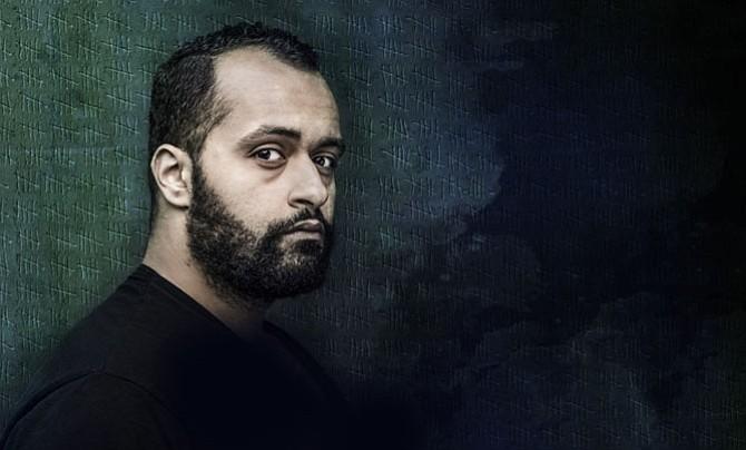 "Ahmad Kamal stars in Signature Theatre's production of ""4,380 Nights."""