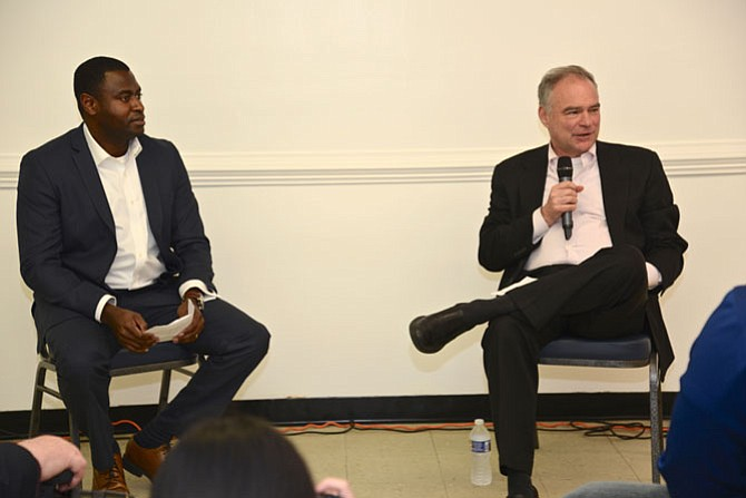 Kofi Annan, president of the Fairfax County NAACP, moderates the Town Hall-style conversation with U.S. Sen. Tim Kaine (D), in a community room above Giardino Italian Restaurant in West Springfield.