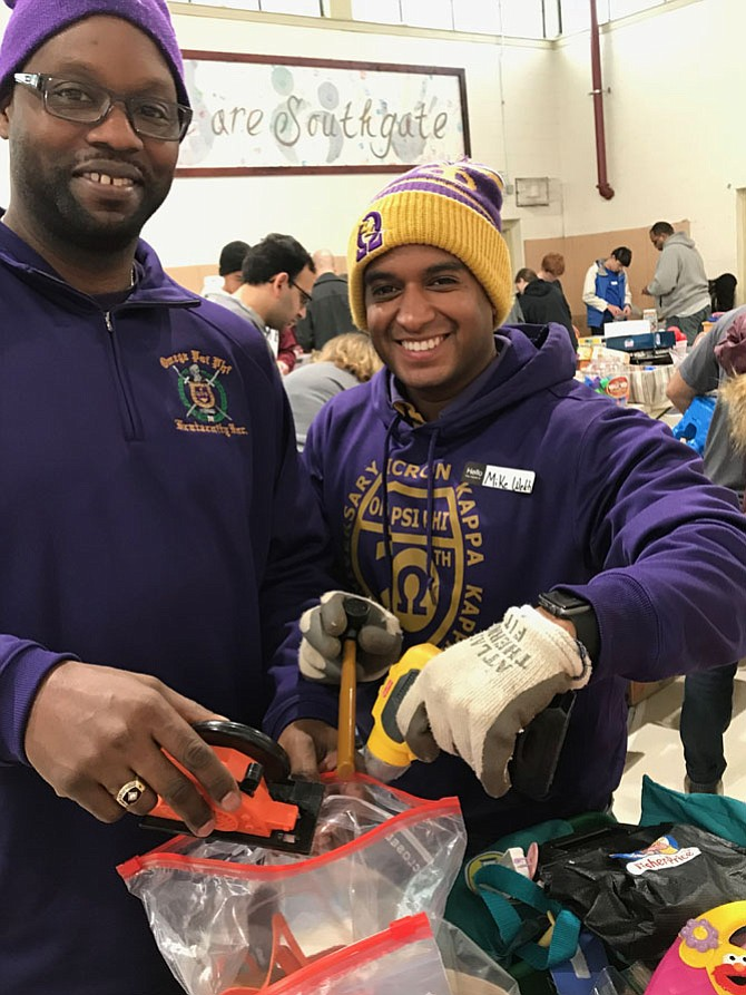 From left: Mike Jones of Alexandria and Michael A. Welch of Reston, Brothers in Omicron Kappa Kappa (OKK) Chapter of Omega Psi Phi Fraternity, Inc. serving Reston/Herndon areas of Fairfax County, uplift their community at Reston Community Center's 33rd annual Reston Martin Luther King Jr. Birthday Celebration kick-off event held at Southgate Community Center in Reston.