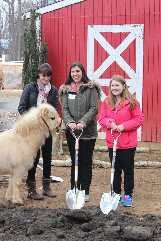 Blythe Champion and Leah Martin, riders at The Northern Virginia Therapeutic Riding Program, with shovels at the groundbreaking ceremony last Wednesday, Jan. 10.