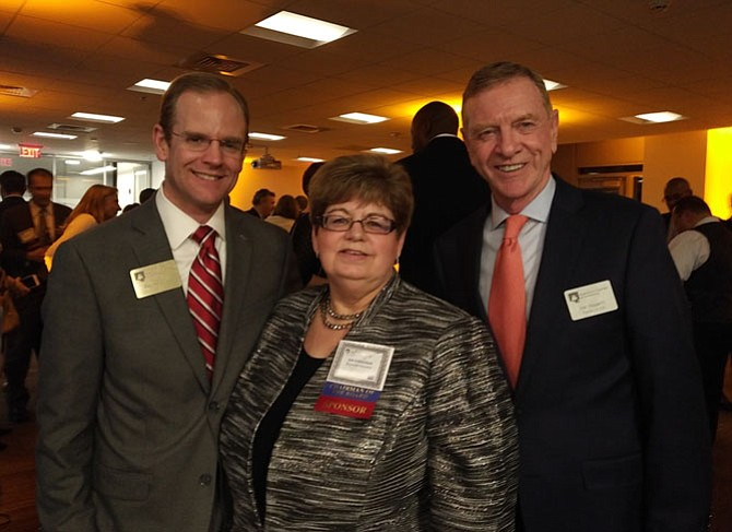 Gin Kinneman, center, celebrates as 2018 Chamber of Commerce board chair with outgoing chair Dak Hardwick, left, and Chamber President and CEO Joe Haggerty at the Chairman's Reception Jan. 18 at Alexandria Renew Enterprises.