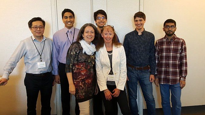 Dr. Alessandra Luchini and her Lyme Innovation Team were awarded $5,000 to help kickstart their winning concept for a Lyme diagnostic. The team includes (front row, from left): Luchini and Deborah Hoadley; (back row, from left): Charles Ma, Tej Ganti, Ather Adnan, David Donna, and Adil Akif.