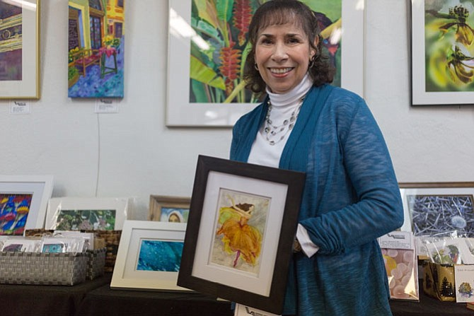 Local artist Joyce Myers, a Vienna resident and a physical therapist, pictured with one of her watercolors on display at Vienna Arts Society's Jazz It Up show Saturday, Jan. 27.