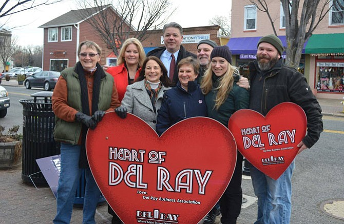Former Heart of Del Ray winners Pat Miller, Bobi Bomar, Jen Walker, Serdar Basegmez, Megan Brown, and Eric Reid present the 2017 Heart of Del Ray award to Margaret Janowsky of Del Ray Cafe. Voting is now open for the 2018 contest.