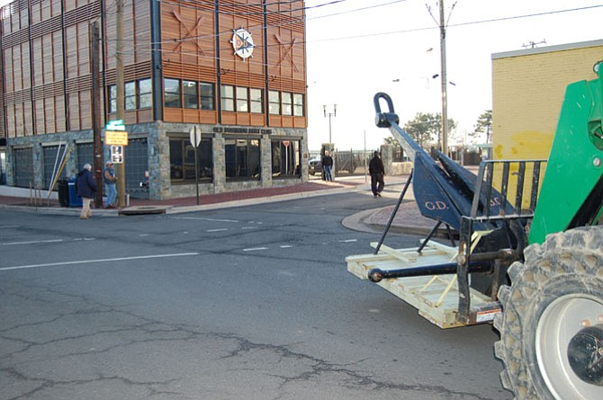 A forklift carrying the ODBC anchor approaches the club's new facility on Strand Street.