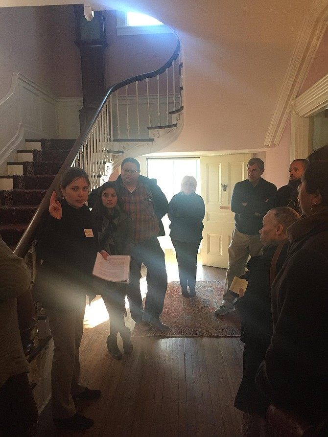 Amanda Roper leads a tour inside of the Lee-Fendall House.