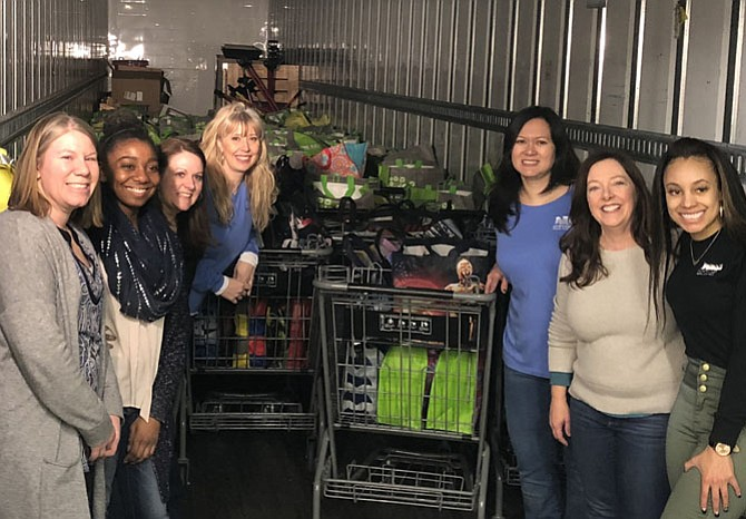 Volunteers from Northwest Federal Credit Union filled 600 bags of food for people to purchase and donate to WFCM's food pantry. (WFCM'S Jennie Bush is second from right).