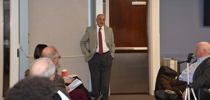 Fred Selden, director of the county's Department of Planning and Zoning, answers questions and listens to comments from the public at a meeting to discuss Plan Amendment 2017-CW-5CP — guidelines designed to streamline the application process to repurpose existing vacant office buildings in suburban and low density residential areas of the county.
