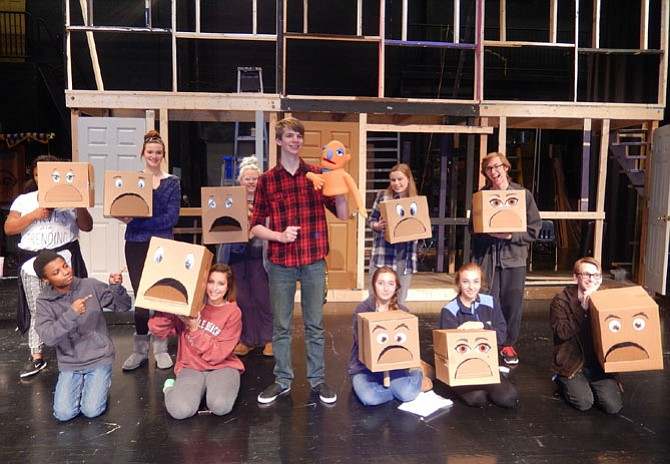 As the character Princeton, Wade Parker turns his moving boxes into puppets.