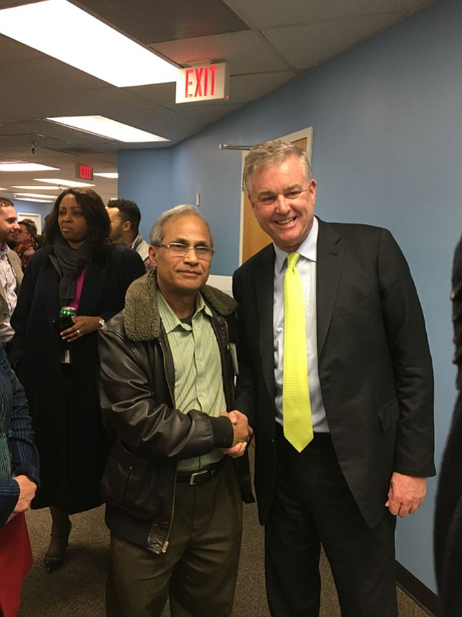 David Trone with Potomac resident Mike Tofigh during the opening of Trone's campaign headquarters Thursday, Feb. 1. Trone is a Democrat running for Maryland's Sixth Congressional District.
