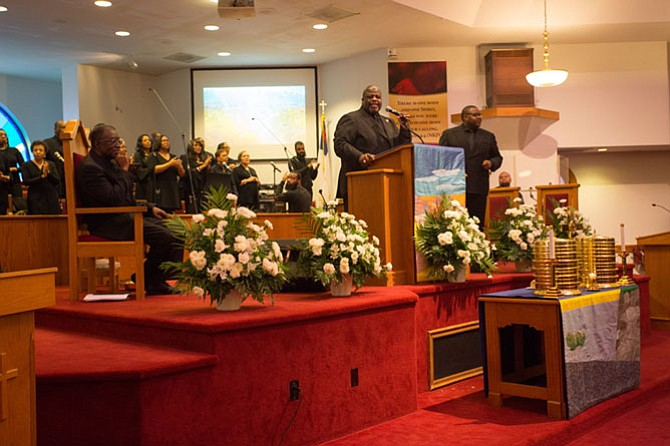 Rev. Vernon Walton (center), senior pastor, gives the sermon on Justice and Legislative Sunday at the First Baptist Church of Vienna Feb. 4.