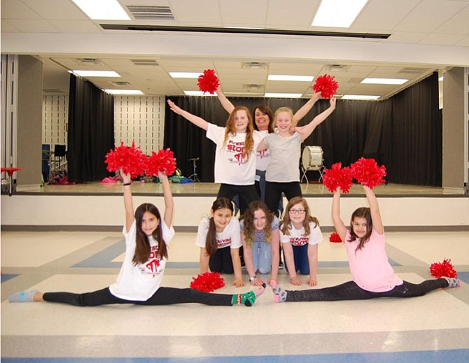 Front row (in splits, from left): Lauren Farfan (fifth grade), Sofia Baranovsky (fourth); Middle row (on knees) Alice Wigmore (fifth), Malory Kroeger (sixth), Maya Seymour (fifth); Back row (on top) Katie Merritt (fifth), Robin DeRosa Lundgren (Coach), and Meredith Lukas (fifth).