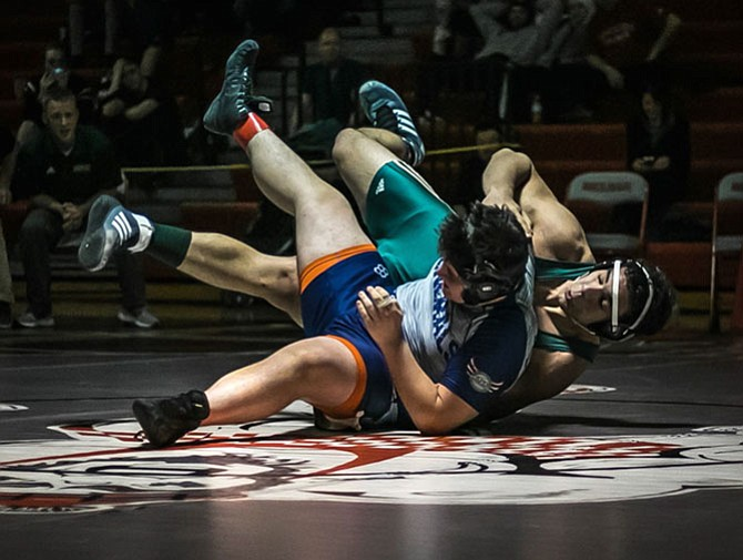 Senior Parsa Yazdani-Arazi from Langley High School won 21-10 against Sophomore Roy McCoy of Washington & Lee High School in the 220 pound weight class.