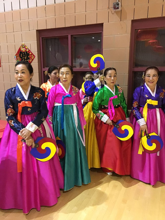 Women from the Korean Culture and Art Center of Maryland line up before performing a Korean Folk Dance at the Lunar New Year Celebration Sunday.