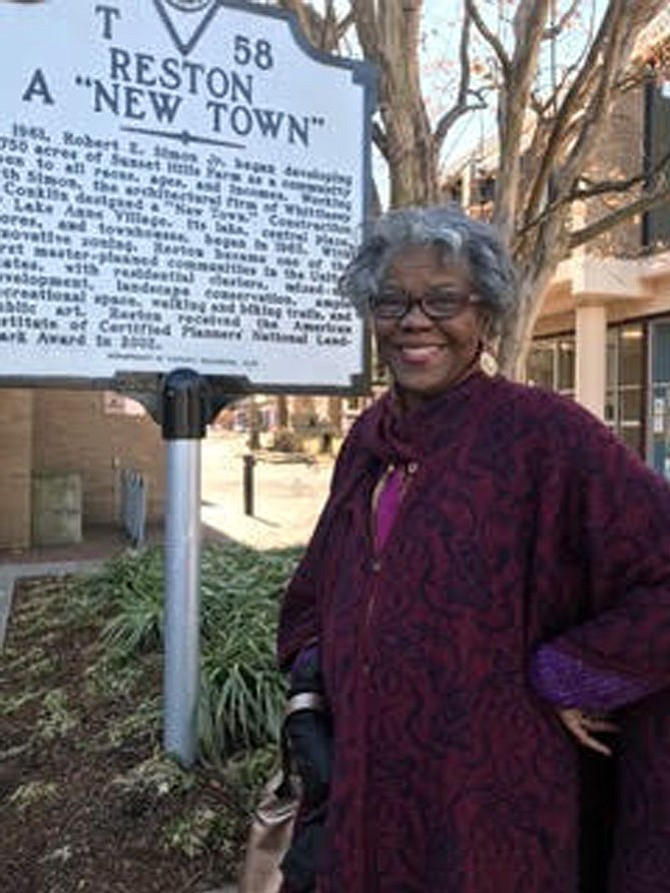 "Rev. LaVerne Gill, author of five books, stands beside the waymarker located at Lake Anne in Reston noting the founding of the planned community. In her most recent book, ""Reston's African American Legacy, Volume No. One"" she celebrates 25 African American pioneers who made a difference in a ""New Town."""
