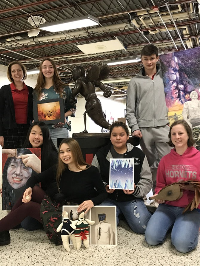 Dr. Liz Noto, Herndon High School principal  (top left) joins students Solveig Reda, Jake Dyer, Estelle Kim, Diane Kovalchuk, Breeana Rivera, and Abby Wilson as they display their award-winning and honorable mention entries in the 2018 Scholastic Art Award competition.