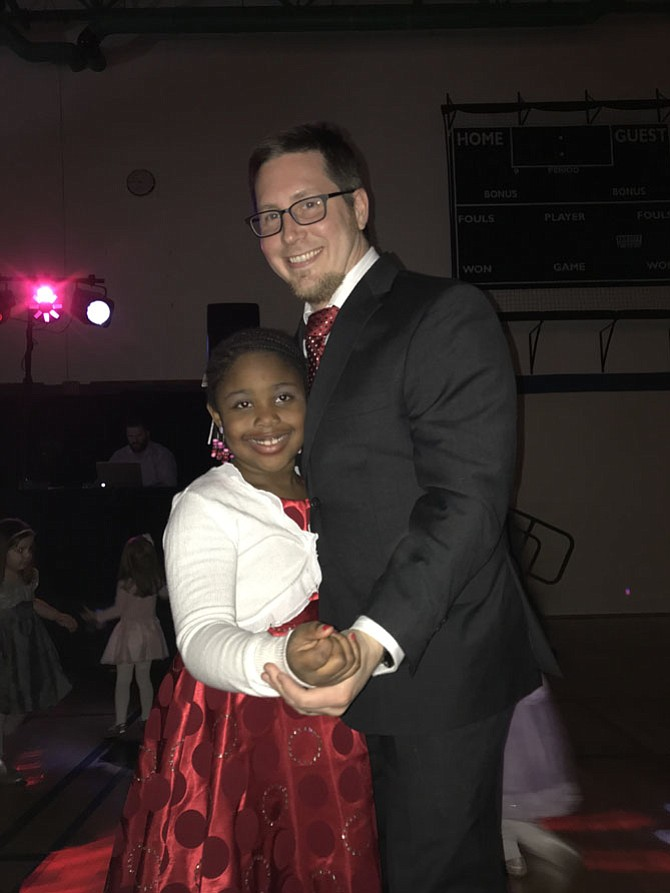 Shaela Mahoney, 7, of Herndon and her dad Devin shine as they hit the dance floor at Herndon Parks and Recreation's Father Daughter Dance.