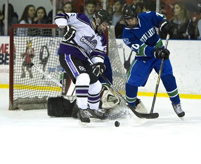 Chantilly's Harris Sciabica #88 and South Lake's Vincent Giordano #70 battle for control of the puck.
