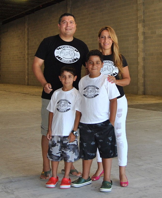 Antonio Maradiaga and his wife Maha Majdoub, with their 10-year-old twins.
