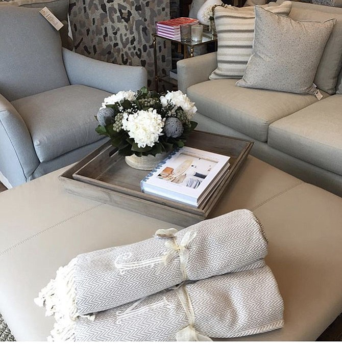 Consider placing coffee table items on a tray, like this one from the Nest Egg, says Interior Designer Susan Tucker.