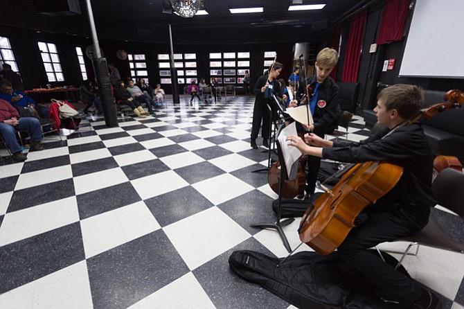 The Langley School middle school orchestra warms up before their performance for the I Love McLean day at the Old Firehouse on Saturday, Feb. 10.
