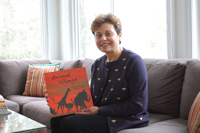 "Nelda LaTeef presents her first piece of artwork which happens to be the cover of her newest children's book, ""Animal Village."""