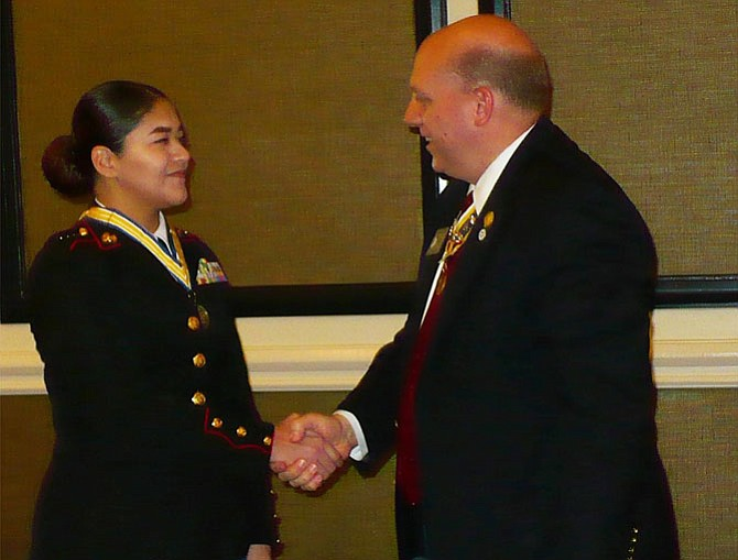 Virginia Society of the Sons of the American Revolution President Michael Elston congratulates Cadet Reyes.