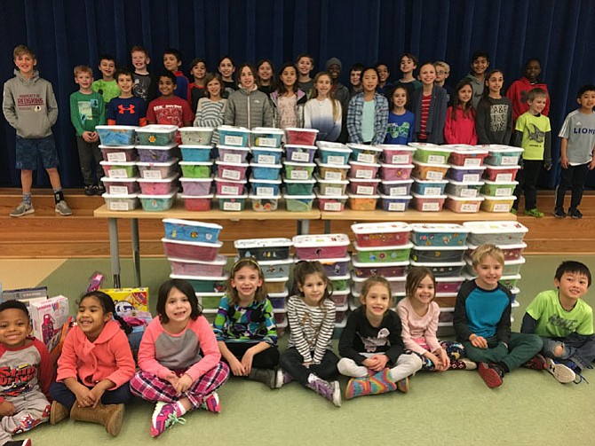 Wayside Elementary School student volunteers show the 100 gift boxes they packed for the Jared Box Project. The boxes will be given to hospitalized children.
