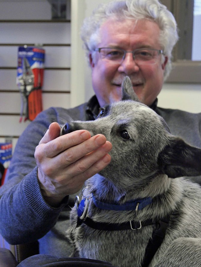 David Heiby, president and CEO of Auto-Grip with office dog, Blue.