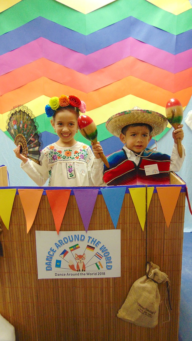Sofia and Diego Escobar of Alexandria are dressed as Mexicans at the International Photo Booth.