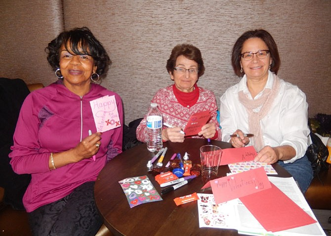 From left: Linda Andrews, Mary Marple and daughter Barbara Marple with some of the valentines they created.
