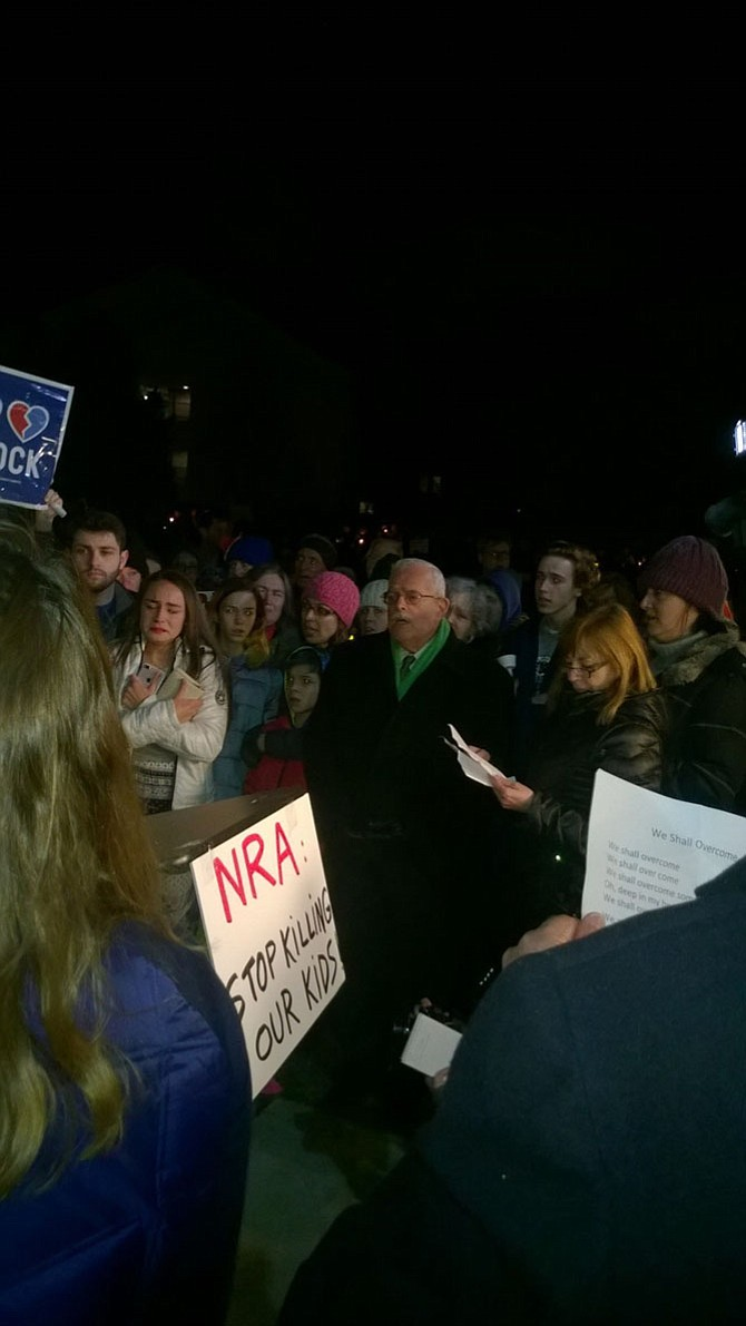 """We are not afraid,"" is the phrase U.S. Rep. Gerry Connolly (D-11) sings Feb. 16 with other participants. The group closed a candlelight vigil with Civil Rights anthem ""We Shall Overcome"" in front of the National Rifle Association headquarters in Fairfax."