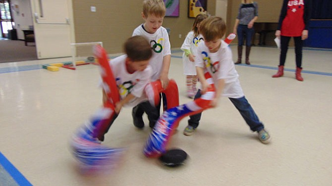 Four-year-olds in Mrs. McPeek's and Mrs. Metcalf's class compete in hockey.