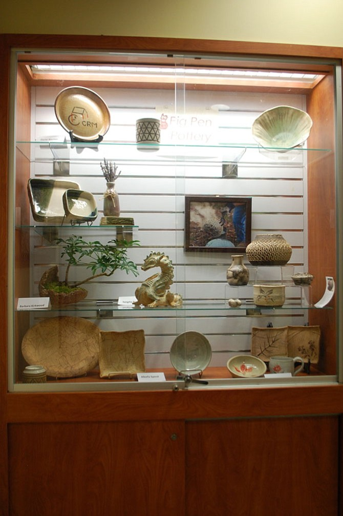 Pottery and other forms of clay work created by Laura Nichols' students of Pig Pen Pottery.