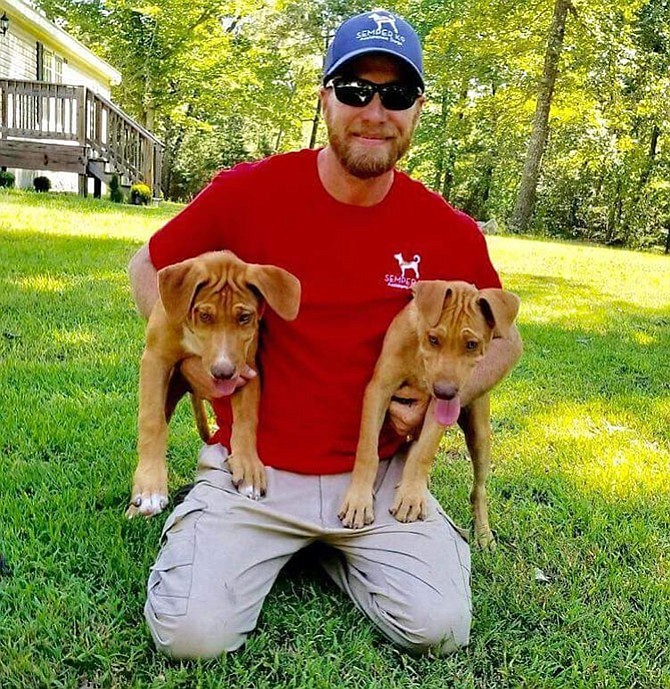 Adoption day for Pete and Duff aka Alvin and Theodore. They are held by Chris Baity, the founder of Semper K9.