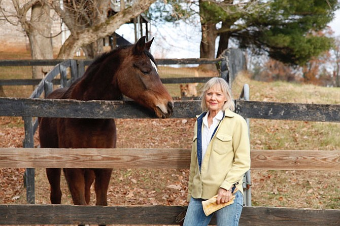 Carole Dell with Fatiyah, an Egyptian Arabian mare. Zina is in the background.