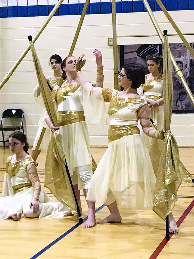"""The award-winning Herndon High School Colorguard combined equipment, dance, gymnastics, music, theater, and performance during their flag, rifle, and sabre show, demonstrated at """"Family Passport to Fun"""" held at the Herndon Community Center on Friday, Feb. 23, 2018."""