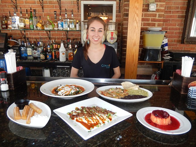 Head bartender Dani Issing with some of Coyote Grille's offerings (back row, from left) Veggie Chili Relleno and Steak Rajas with beans and rice, and (front row, from left) Churros with Ibarria Chocolate Sauce, Carne con Crema de Maiz, and Sweet Potato Flan with fresh berry compote.