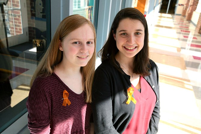 T.C. Williams High School students Hannah Miller (left) and Jay Falk organized a day against gun violence on Tuesday. Their #WeAreAllEagles event was adopted by the school, prompting over 1,000 T.C. students to wear ribbons and the school colors of Marjory Stoneman Douglas High School in Parkland, Fla., which suffered 17 deaths from a shooting on Feb. 14.