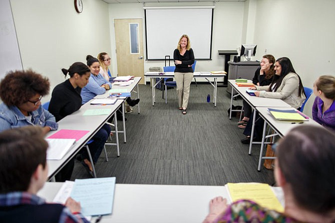Mental health counseling professor Lisa Jackson-Cherry, Ph.D. leads a class discussion with future therapists about discussing high-profile tragedies with children.