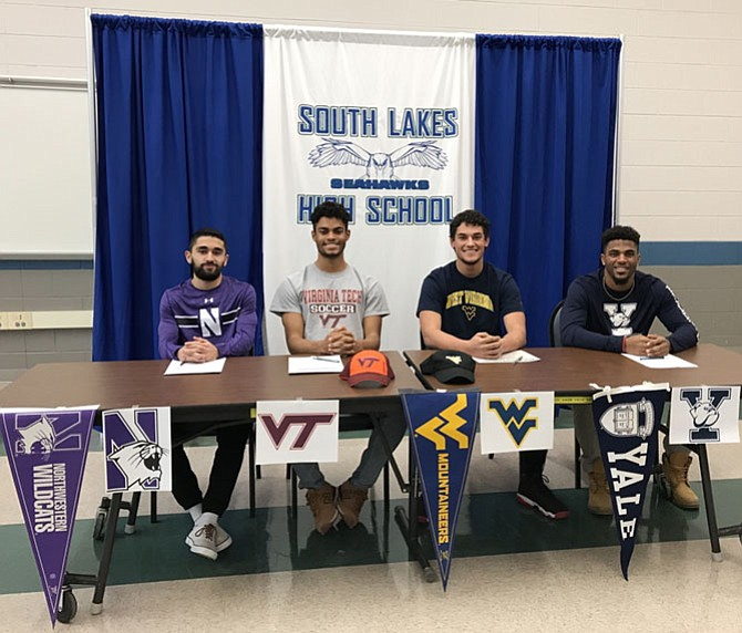 On Feb. 14, four South Lakes High School student-athletes celebrated making their formal commitments to four Division I colleges, from left: Bardia Kimiavi for soccer at Northwestern; Kahlil Dover for soccer at VA Tech; Evan Matthes for football at WVU and Spencer Alston for football at Yale.