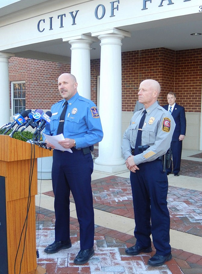 (From left) Fairfax City Police Chief Carl Pardiny and Fairfax County Police Chief Ed Roessler hold a press conference Monday evening about the arrest of a teen who allegedly threatened Fairfax High School.