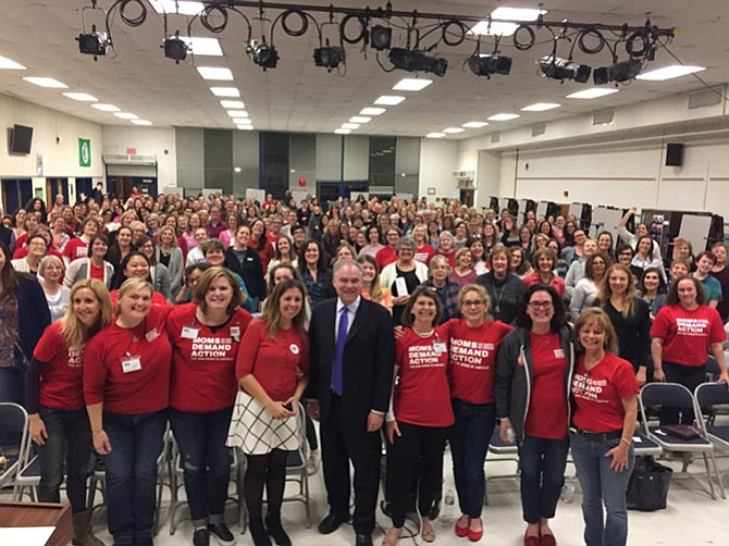 Sen. Tim Kaine (center) spoke at the Moms Demand Action meeting at Frost Middle School in Fairfax on Feb. 28, where some 300 people attended.