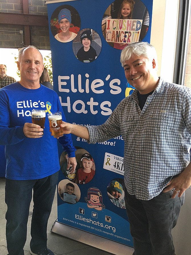 Jay Coakley and Sean Hunt toast to Ellie's Hats' fourth anniversary.